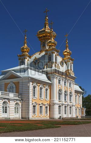 PETERHOF, ST. PETERSBURG, RUSSIA - JUNE 4, 2017: East Chapel flanking the central buildings of Grand Peterhof Palace. The palace-ensemble along with the city center is a UNESCO World Heritage site