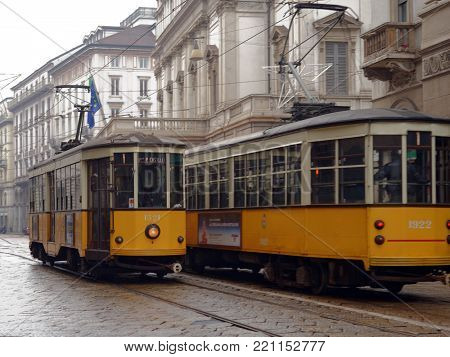 MILAN, ITALY - JANUARY 2, 2013: Old trams works on line in Milan, Italy on January 2, 2013. The oldest still operating 1500 series of tramway had introduced in 1927
