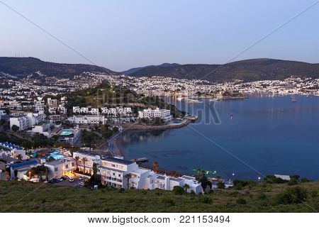 BODRUM, TURKEY - APRIL 15, 2014: Blue hour cityscape with the St. Peter's castle. Built in XV century, now the castle housed the Museum of Underground Archeology