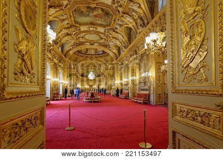 PARIS, FRANCE - SEPTEMBER 14, 2013: Tourists in the Luxembourg Palace during European Heritage Day. The palace was originally built in XVII century, and since 1958 it houses the French Senate