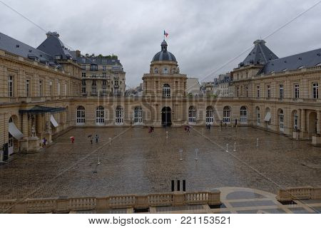 PARIS, FRANCE – SEPTEMBER 14, 2013: Tourists in the courtyard of Luxembourg Palace during European Heritage Day. The palace was built in XVII century, and since 1958 it houses the French Senate