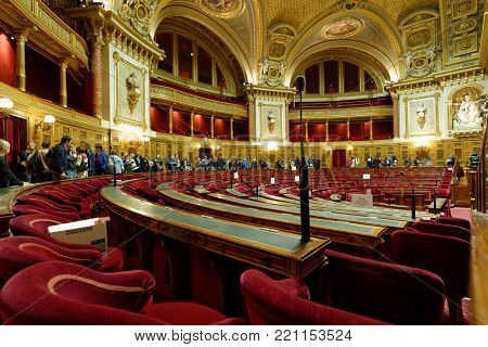 PARIS, FRANCE – SEPTEMBER 14, 2013: Tourists in the Meeting hall of Senate in the Luxembourg Palace during European Heritage Day. The palace was originally built in XVII century
