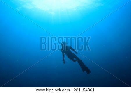 Freediver apnea swimming underwater