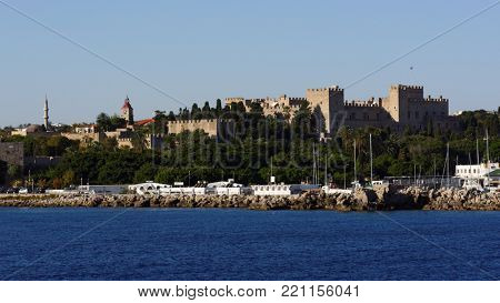 RHODES, GREECE – OCTOBER 12, 2017: Citadel and port viewed from the sea. Medieval city of Rhodes is listed as UNESCO World Heritage since 1988
