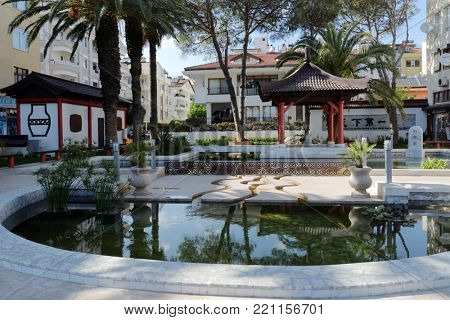 MARMARIS, TURKEY - APRIL 1, 2014: Arbor and fountain in Jinan park. Chinese town of Jinan is the sister city of Marmaris since 2009