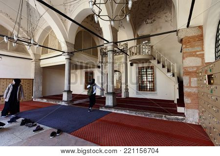 ISTANBUL, TURKEY – OCTOBER 13, 2017: Muslim girls enter to Haci Besir Aga mosque after visiting the madrasa. The mosque and madrasa was built in 1745