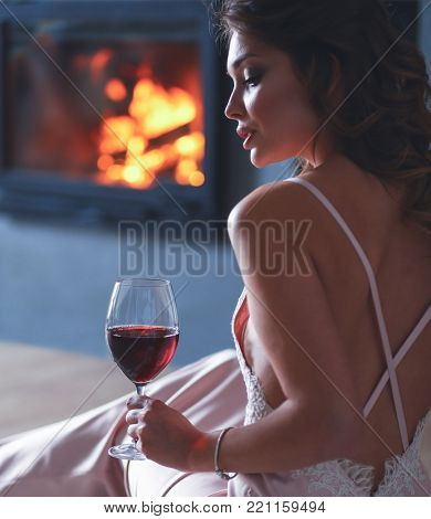 Sexy girl in front of the fireplace