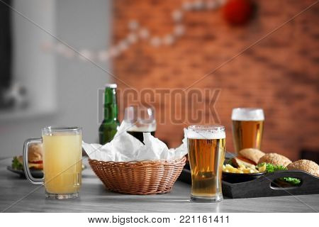 Table served with beer and snacks in sport bar