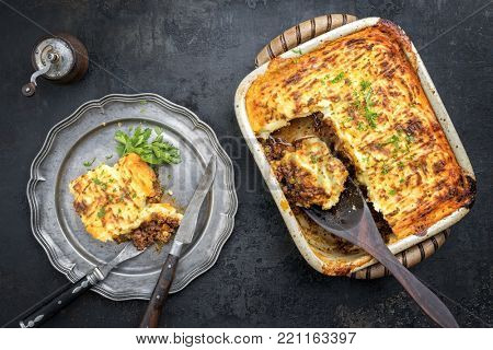 English shepherds pie as top-view on a pewter plate and backing dish