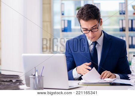 Businessman working with paperwork in the office