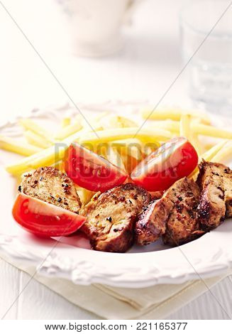 Pork Tenderloin with French Fries