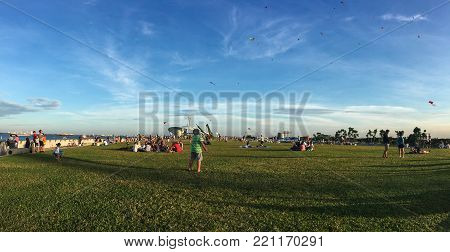 Singapore - Mar 12, 2016. People enjoying at city park of Singapore. Singapore is a global financial center with a tropical climate and multicultural population.