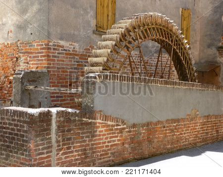 Image of an old abandoned mill in the alleys of the village of Soncino - Italy