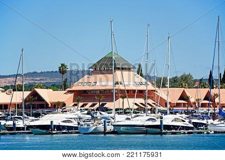 VILAMOURA, PORTUGAL - JUNE 6, 2017 - View of yachts in the marina with buildings to the rear, Vilamoura, Algarve, Portugal, Europe, June 6, 2017.