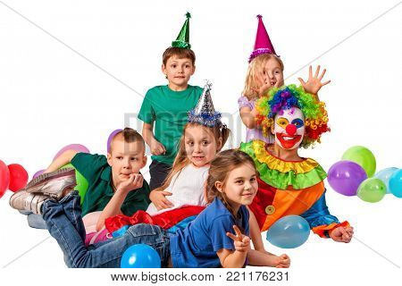 Birthday child clown playing with children and bunny fingers prank. Kid posing for photo and smiling. Holiday cakes celebratory and balloons the happiest birthday.