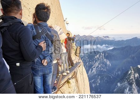 Mount Hua, Shaanxi Province, China - October 6, 2017: Tourists On The Plank Walk In The Sky, Worlds