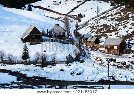Traditional Homestead With Wooden Houses In Transylvania, Romania