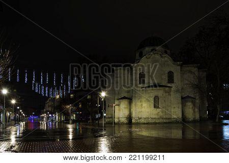 Panorama of the Saint nicholas church in Varna downtown, Bulgaria , by a rainy night.