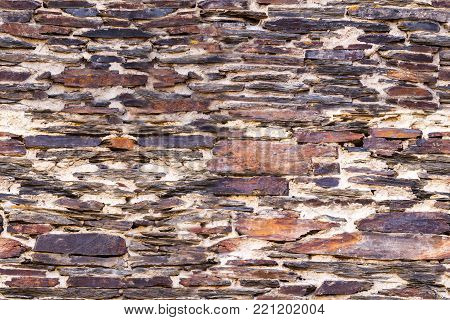 Brown ancient stonework or masonry wall as seamless pattern poster
