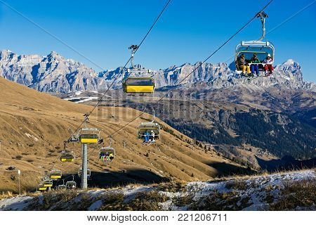 DOLOMITES, ITALY - DECEMBER 30, 2016: Winter landscape with ski lift transporting skiers on December 30, 2016 at the Dolomites, Italy