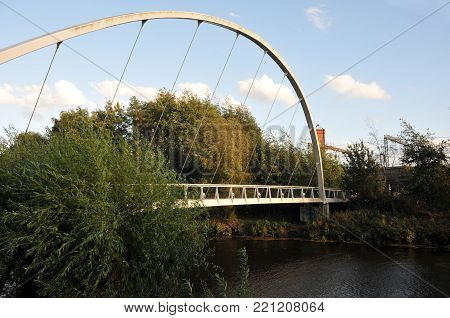 metal pedestrian footbridge crossing the river aire in leeds