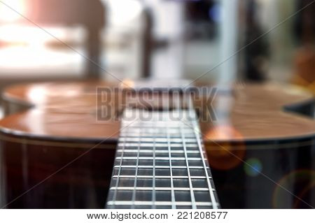 Guitar of a guitar close-up in horizontal position, soft focus