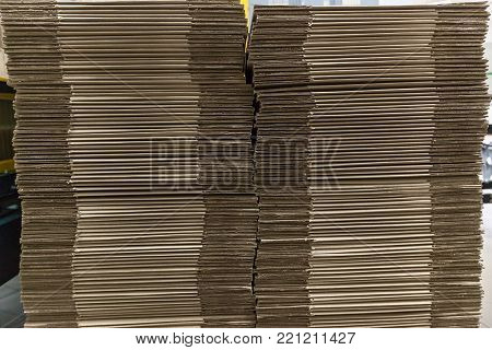 Cross section of stacked corrugated cardboard. stack of brown cardboard sheets on background. Corrugated stacked cardboard