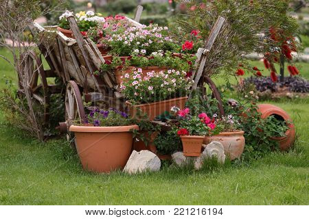 Retro wain with flowers in a garden
