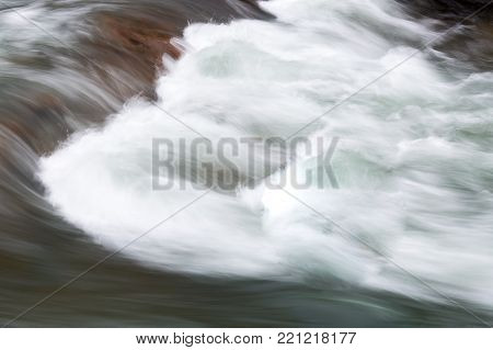 power of nature, background, rafting concept. photo that was taken in long exposure, that depicted fast moving flow of river, how rough can be water in the stage of rapids