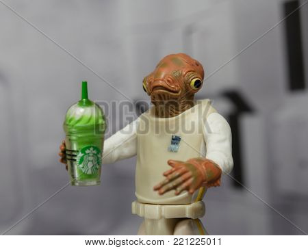 NEW JERSEY USA - JAN 4 2018: Star Wars Rebel Admiral Ackbar who's famous for saying It's A Trap! in Return of the Jedi - using Hasbro Action Figure holding Starbucks Frappuccino - It's A Frapp!