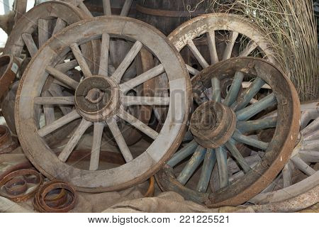 Group of Antique Wooden Chariot s Wheels.