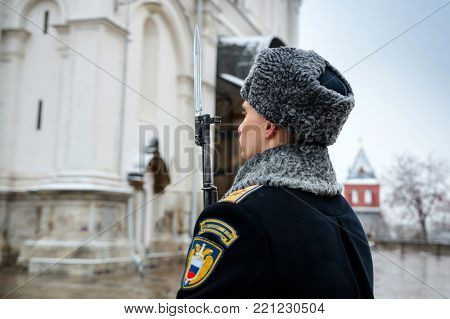 MOSCOW, RUSSIA - DECEMBER 09, 2017: The Honor Guard of the Presidential Regiment of the Service of Moscow Kremlin's Commandant of the Federal Guard Service of the Russian Federation. Winter view. Cathedral Square, Kremlin, Moscow.