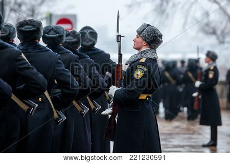 MOSCOW, RUSSIA - DECEMBER 09, 2017: March-past (parade) of the Presidential Regiment of the Service of Moscow Kremlin's Commandant of the Federal Guard Service of the Russian Federation. Winter view. Cathedral Square, Kremlin, Moscow.