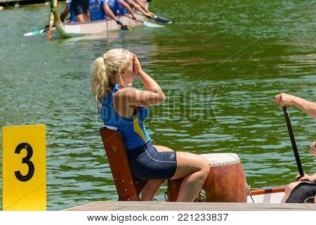 Rome, Italy - July 30, 2016: Dragon boat crews  compete at the european championships held in Italy in 2016 summer, Swedish girl tired after the race