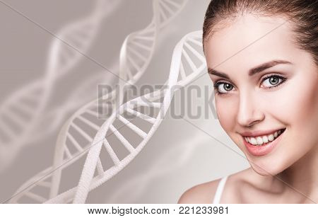 Young sensual woman among DNA chains over gray background. Biochemistry skin concept.