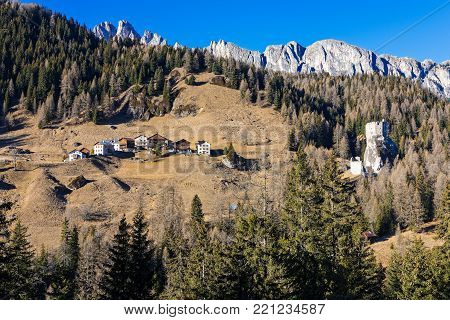 Landscape with houses and ruined castle at the Dolomites in northeastern Italy