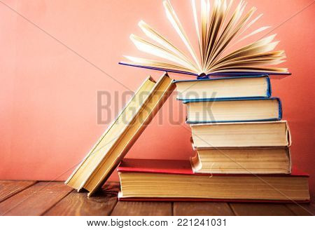 book. many books. Stack of colorful books. Education background. Back to school. Book, hardback colorful books on wooden table. Education business concept. Copy space for text