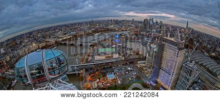 LONDON, ENGLAND - NOVEMBER 28, 2017: Panoramic view at oane part of city, at dusk time, from London Eye capsule. Giant Ferris wheel on the Bank of the River Thames has 135m tall and 120m in diameter.