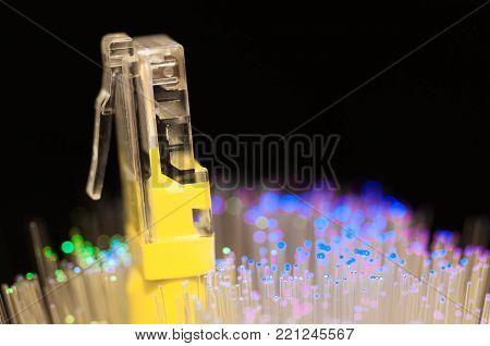 Yellow internet switch close up macro shot , blue , green  optical fibres.