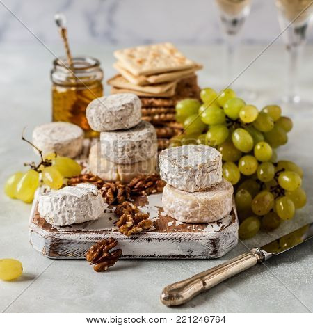 Cheese Platter, Variety of French Cheeses, Green Grapes, Walnuts, Honey and Crackers, square