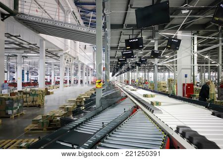 TVER, RUSSIA - MAY 17, 2017: Working people in warehouse and sorting center of Ozon internet shop, it takes sixth place in list of most expensive russian internet companies