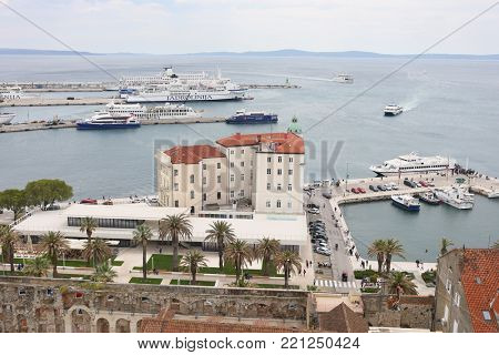 SPLIT, CROATIA - MAY 21, 2017: Seaport with ships Jadrolinija in Split, top view. The port of Split is one of the largest on the Adriatic coast