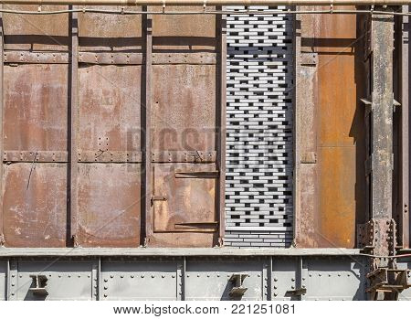 weathered rusty industrial scenery with old corroded steel plates and girders