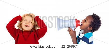 Funny little boy shouting through a megaphone to his friend. Isolated on white background
