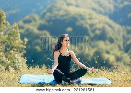Smiling Woman Meditating Outdoors on the Mat in Yoga Pose