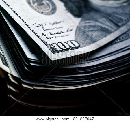 money on a wooden background. lot 100 dollars, business composition a
