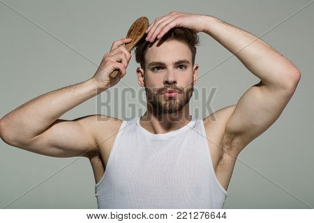 Man Brush Hair With Hairbrush On Grey Background