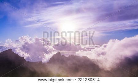 Amazing view of mountain peaks with beautiful clouds on the sunset. Location: Tenerife, Canary Islands, Spain. Artistic picture. Beauty world.