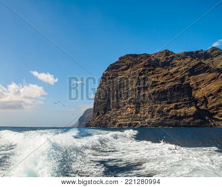 Amazing view of high cliffs from the boat. Location: Los Gigantes, Tenerife, Canary Islands. Artistic picture. Beauty world.