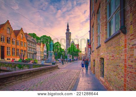 Brugge sunset cityscape, Belgium. Stunning street view of Brugge city centre.